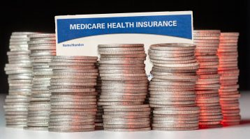 medicare savings program Medicare card with silver coins